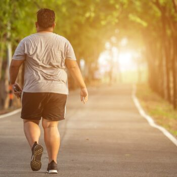 Exercise and healthy concept : Fat man running in the park